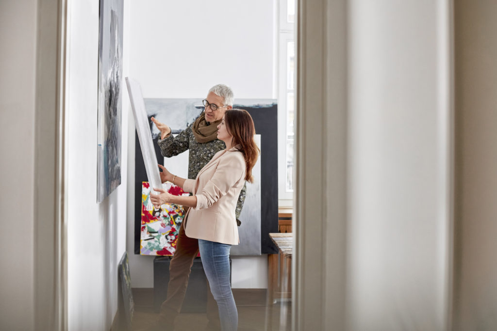 Photo of Artist Selling Painting by Getty Images | What You Need to Know to Sell Your Art | Artists Network
