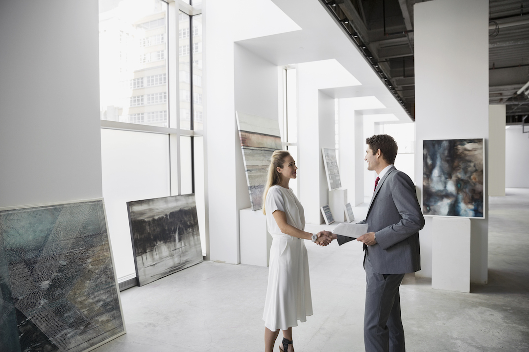Photo of artist making an art deal courtesy of Getty Images | What to Know Before You Sell Your Art